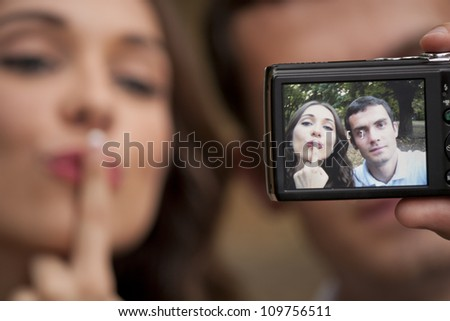 Young couple take a picture together - stock photo