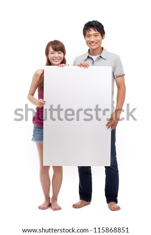 Young couple take white panel isolated on white background.