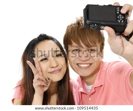 Young couple taking a photo of themselves - stock photo
