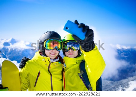 Young couple taking a selfie - stock photo