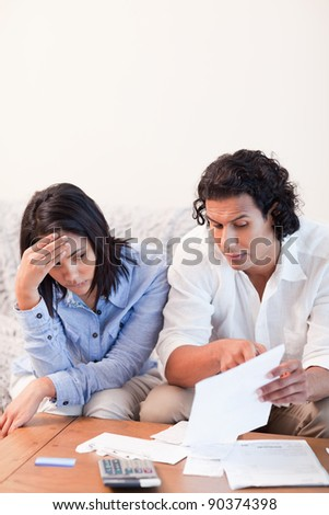 Young couple talking about bad news they got by mail - stock photo