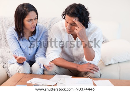 Young couple talking about financial problems - stock photo
