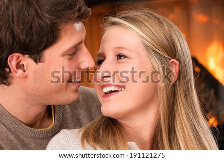 Young couple talking and hugging during romantic date - stock photo