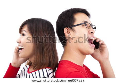 Young couple talking on the phone - stock photo