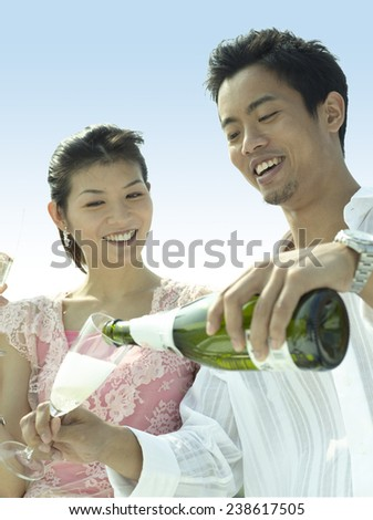 Young Couple Toasting at Yacht Party - stock photo