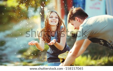 Young couple together having fun outside. - stock photo