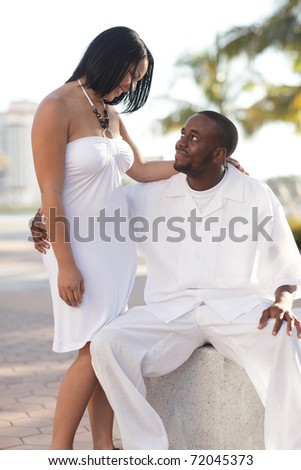 Young couple together in the park - stock photo