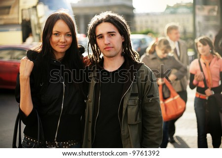 Young couple together on a street - stock photo