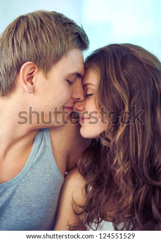 Young couple touching by their faces