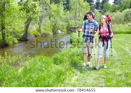Young couple tourists walking in park. Adventure. - stock photo