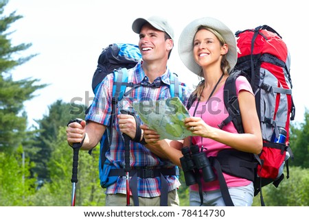 Young couple tourists with map in the park. Adventure. - stock photo