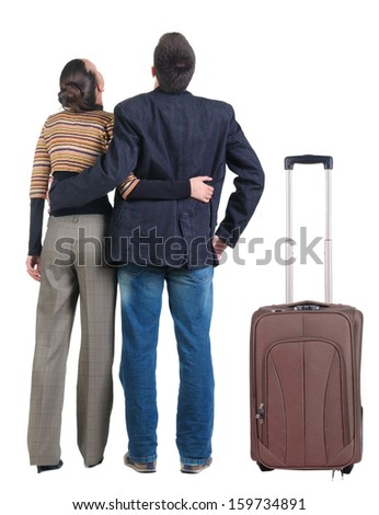 Young couple traveling with suitcas. Rear view. Isolated over white. - stock photo