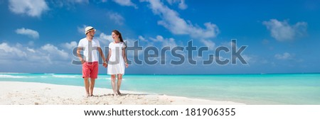 Young couple tropical at beach during summer vacation - stock photo