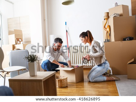 Young couple carrying big cardboard box stock photo 427668385 shutterstock - Young couple modern homes ...