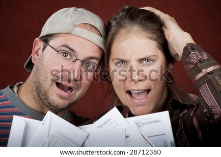 Young couple upset over too many bills - stock photo