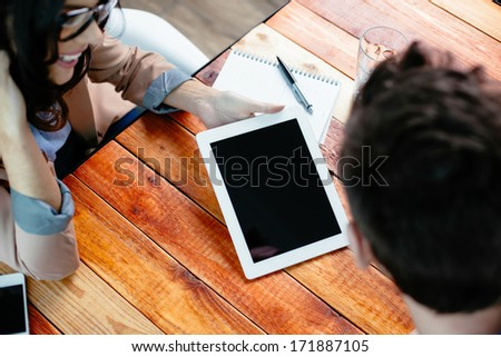 Young couple using a digital tablet - stock photo