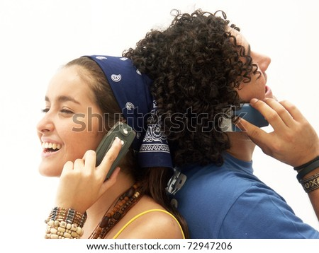 Young couple using a mobile phone. Young couple talking themselves by mobile phone. - stock photo