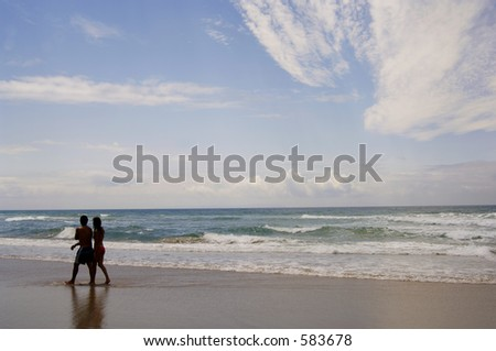 Young couple walking along the beach