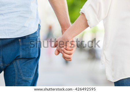 Young couple walking hand to hand