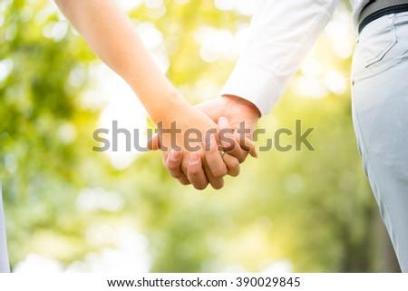 Young couple walking, Hyde Park, London: sunset colour tone - stock photo