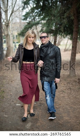 Young couple walking in park in the city