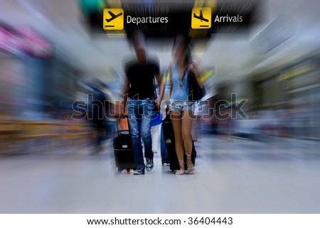 Young Couple Walking in the Airport Terminal - stock photo