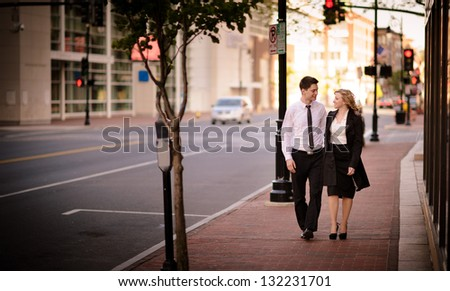Young couple walking in the city - stock photo