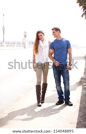 Young Couple walking in the city of Los Angeles, California - stock photo