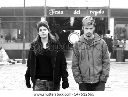 Young Couple walking in the PiazzaTrento e Trieste Christmas market Ferrara Italy - stock photo