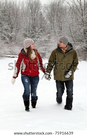 Young Couple Walking In the Snow