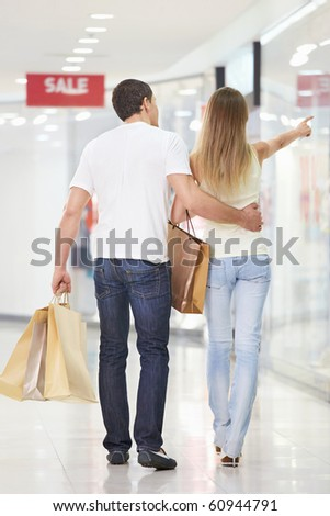 Young couple walking through the store - stock photo