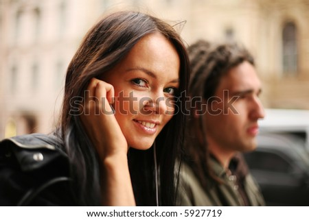 Young couple walking together in a street - stock photo