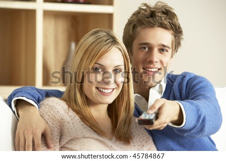 Young Couple Watching Television Together - stock photo