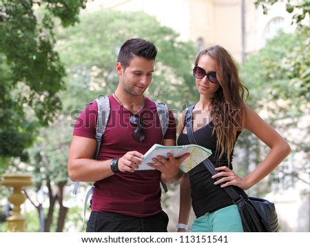 Young couple watching the city map - stock photo
