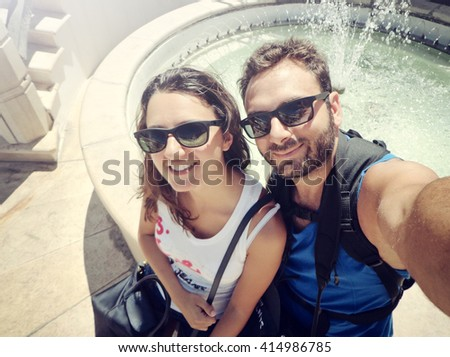 Young couple while taking a Selfie in Ostuni, Italy - stock photo