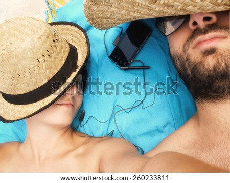 Young couple while taking a Selfie on the beach. - stock photo