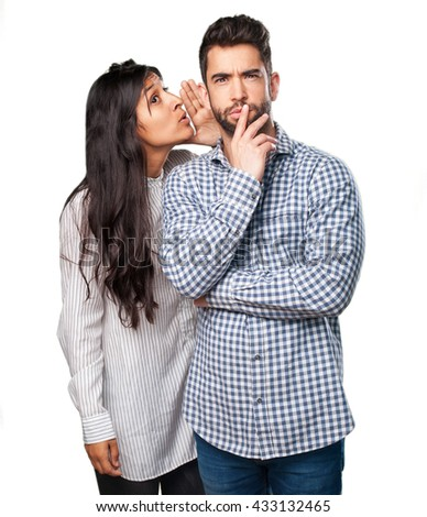 young couple whispering - stock photo