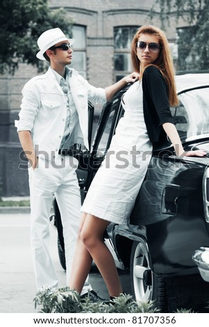 Young couple with a car - stock photo