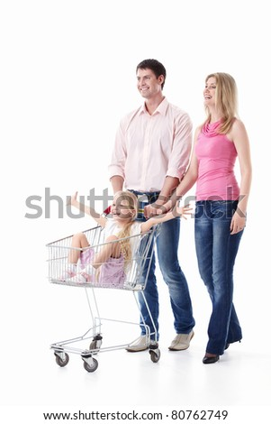 Young couple with a child with a trolley for shopping isolated - stock photo
