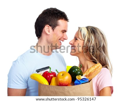 Young couple with a grocery shopping bag. Isolated on white background. - stock photo