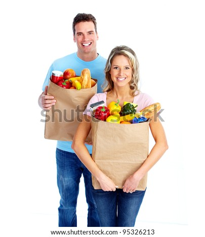 Young couple with a grocery shopping bag. Isolated on white background.