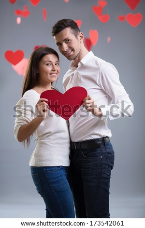 Young couple with a heart - stock photo