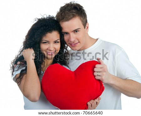 Young couple with a heart over white background - stock photo