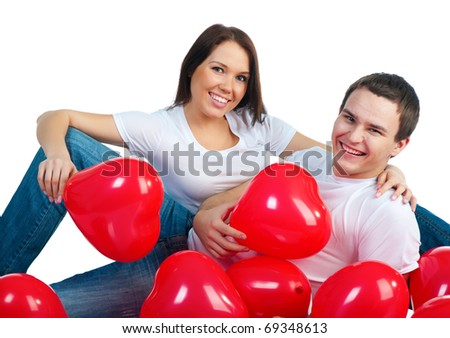 Young couple with a hearts over white background - stock photo