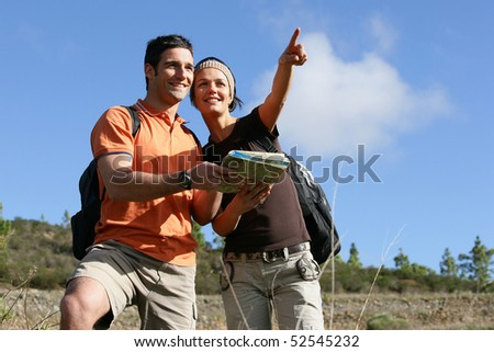 Young couple with a plan - stock photo