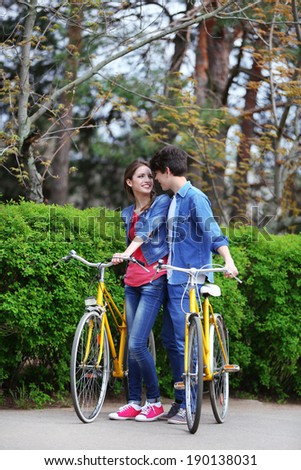 Young couple with bicycles in park