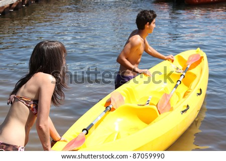 Young couple with boat - stock photo