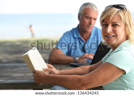 Young couple with book - stock photo