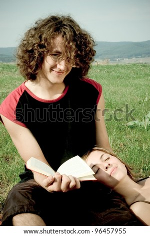 young couple with book