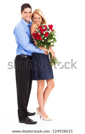 young couple with bunch of roses full length portrait